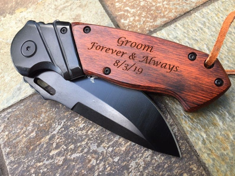 male gift exchange ideas:Engraved Pocket Knife