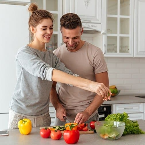 quarantine anniversary ideas: cooking together